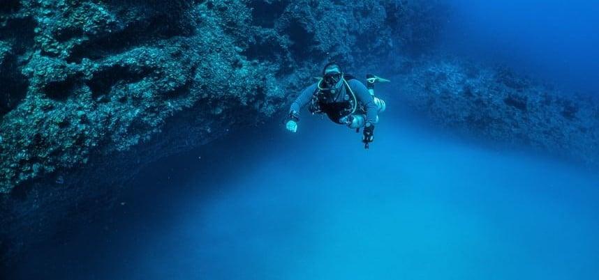 Diver floating over King Kong's Blue Hole